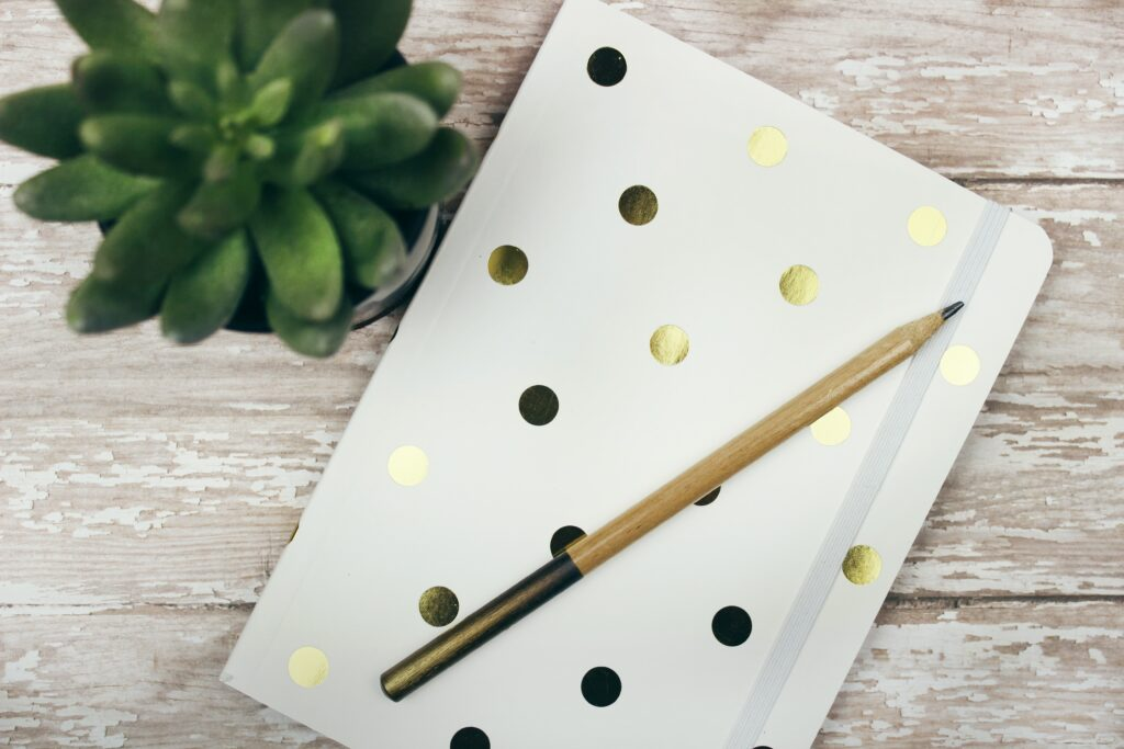Gold polka dotted journal and pen